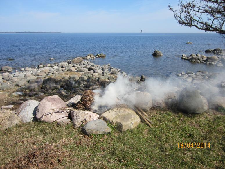 Bonfire at rocky seashore